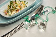 Serving table with christmas decoration. On white tablecloth Royalty Free Stock Image