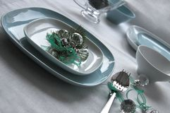 Serving table with christmas decoration. On white tablecloth Stock Photography