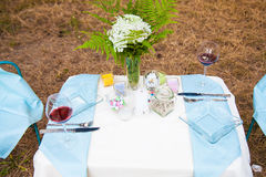 Serving table decoration on nature Royalty Free Stock Image