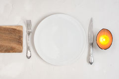 Serving table with empty plate Royalty Free Stock Images