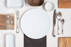Serving table with empty plates Royalty Free Stock Images