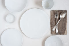 Serving table with empty plates Royalty Free Stock Photography