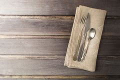 Serving table with rustic style and old flatware on wooden table. With copy space stock photo
