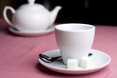 Serving table with tea. Serving teaspot with empty cup, sugar and teaspoon in the cafe Royalty Free Stock Photos