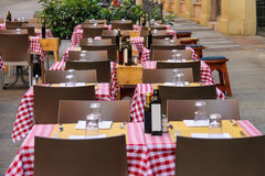 Serving tables in the  Italian outdoor restaurant. Stock Photo