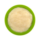 Serving of tapioca pudding in a green bowl top view. Top view of a serving of fresh tapioca pudding in a small green bowl isolated on a white background Royalty Free Stock Photos
