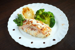 Serving of tasty baked fish with vegetables Stock Photography