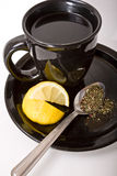 Serving tea. A cup of tea being served with lemon and spoon Royalty Free Stock Photo