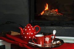 Serving Tea in front of fireplace Royalty Free Stock Images