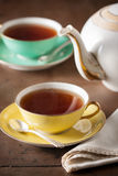 Serving tea on a table Royalty Free Stock Image