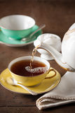Serving tea on a table Stock Image