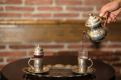 Serving tea in traditional silver set Stock Image