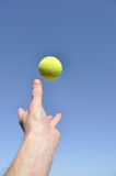 Serving a Tennis Ball Royalty Free Stock Image