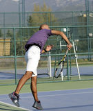 Serving a tennis ball Royalty Free Stock Photography