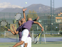 Serving a tennis ball. Into net. young man posing. This study, which was created from photos taken at serial royalty free stock photo