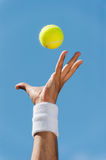 Serving tennis ball. Royalty Free Stock Photography