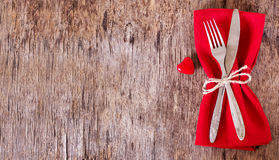 Serving on Valentine's Day. Fork, knife, napkin, heart. Celebrate valentine's day.  Serving, Table decoration Valentine's Day, table set with a decorative heart Royalty Free Stock Photos