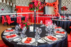 Serving of the wedding table, beautiful festive decor in red stock photography