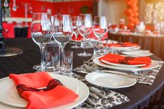 Serving of the wedding table, beautiful festive decor in red royalty free stock images