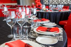 Serving of the wedding table, beautiful festive decor in red royalty free stock photo