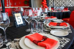 Serving of the wedding table, beautiful festive decor in red royalty free stock image