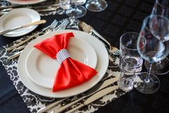 Serving of the wedding table, beautiful festive decor in red royalty free stock photography
