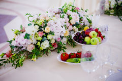 Serving wedding table flowers. Design Bureau for newlyweds Royalty Free Stock Photo