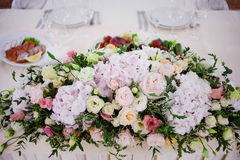 Serving wedding table flowers. Design Bureau for newlyweds Stock Image