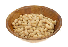 Serving of white beans in wood bowl Stock Photos