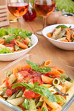 Servings of colored penne pasta Royalty Free Stock Photos