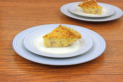 Servings of quiche lorraine on plates Stock Photo