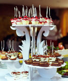Servings of sweet tasty dessert on buffet Royalty Free Stock Photography