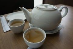 Servire della tazza di tè della porcellana Fotografia Stock