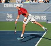 Servire di tennis di Isner Fotografie Stock Libere da Diritti