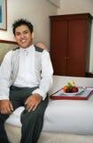 Servizio di stanza nella camera di albergo Immagine Stock