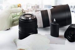 Servizio e riparazione di attrezzatura della foto Fotografie Stock Libere da Diritti