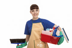 Servo femminile caucasico sorridente With Cleaning Accessories fotografia stock