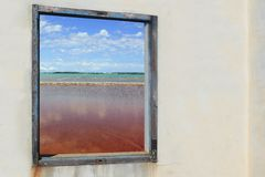 Ses salines formentera view from wooden window Royalty Free Stock Photos