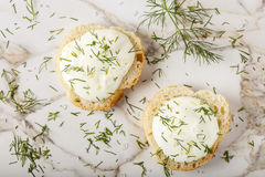 Sesame bagel with cream cheese, dill and salt Royalty Free Stock Images