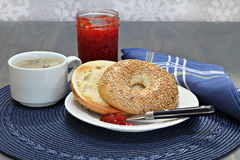 Sesame bagel, toasted and buttered with homemade strawberry jam Royalty Free Stock Photography