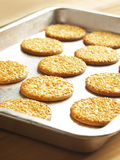Sesame biscuits. Tray of freshly baked sesame biscuits Royalty Free Stock Photo