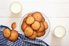 Sesame biscuits with milk for breakfast for children. Royalty Free Stock Image