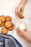 Sesame biscuits with milk for breakfast for children. Stock Images