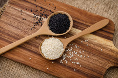 Sesame black and white in wooden spoon on Wood background. Sesame black and white in wooden spoon Stock Photos