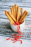 Sesame bread sticks in white cup Royalty Free Stock Photography