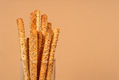 Sesame breadsticks in clear glass Royalty Free Stock Images