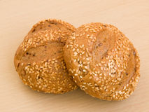 Sesame buns. Two sesame buns on the wooden background Stock Photography