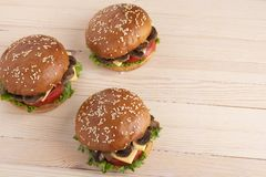 Sesame buns with cheese and mushroom and tomatoes, raw vegetbles on kitchen royalty free stock photos