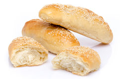 Sesame buns whole and broken Royalty Free Stock Photography