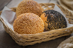 Sesame buns in wicker basket Stock Images